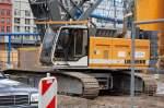 LIEBHERR/107070/diverse-hydrauseilbagger-waren-auf-der-schlecht Diverse Hydrauseilbagger waren auf der schlecht einsehbaren Großbaustelle Hakescher Markt Berlin Mitte tätig, hier ein LIEBHERR Typ? der Fa. BILFINGER BERGER, 08.07.08
